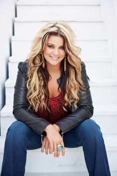 Lauren Alaina. She is flat out gorgeous! i wish my hair would look like this! I love it!