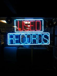 A welcome sign. USED RECORDS neon sign.