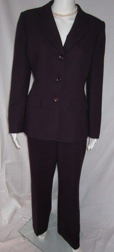 Grape colored, lined jacket and lines boot cut pants. Perfect for red wine drinkers!    Length of jacket is 26 inches.  Pant inseam is 29 inches.  40 inch bust.     $34.00