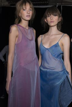 We can see ourselves going from one party to another in the shimmering pink gauze asymmetric spaghetti dress! Hello iridescence for SS14. #MarquesAlmeida #LFW #SS14 #Newgen #Topshopsupport