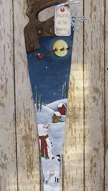 Snowman and Santa Handsaw.  I have several hand saws that need painted.  I like this angle.