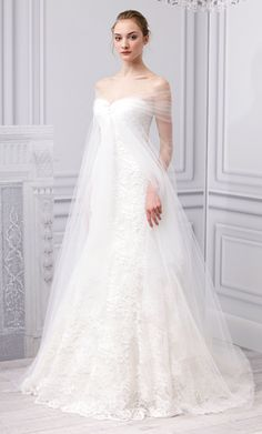 """Our 5 Favorite Looks from #MoniqueLhuillier's New Wedding Dress Collection: """"Escape"""" Silk White Gown with Gathered Tulle Cape. http://news.instyle.com/photo-gallery/?postgallery=109011"""