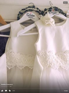 Flower girl dresses wth guipure at the waist,on hand labelled hangers by Joy at her wedding.