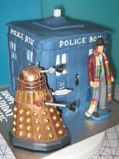 """Dr Who Tardis"" Cake: vanilla sponge filled with jam and buttercream, covered and hand-decorated with sugarpaste, plus Dr Who & Dalek figures"