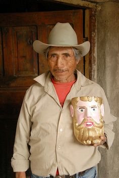 Arturo is a Purepecha mask carver who lives near Lake Patzcuaro in the state of Michoacan. He carved the mask in his hand. Mexican Mask, His Hands, Cowboy Hats, Mexico, Carving, Culture, Western Hats, Wood Carving, Sculptures