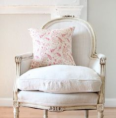 Chalky aged white antique French chair and  a lovely touch of washed pink paisley in the pillow