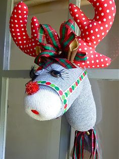 Sock Reindeer. Full tutorial telling us how to make this. I think it's so cute!!
