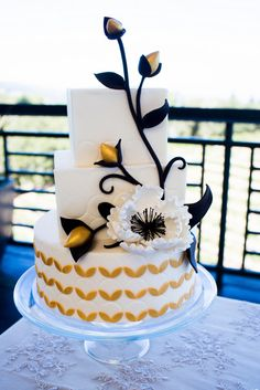 Black and Gold Wedding Cake from Studio Cake on a Lace Runner from Napa Valley Linens