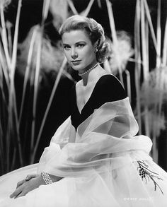 Grace Kelly wearing a black-and-white Edith Head dress for her first scene in Hitchcock's Rear Window (1954).