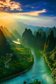 Watching the sunrise from the top of Mount Xiang Gong (Guilin of China) by Tian Ma