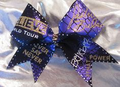JUSTIN BIEBER CONCERT CHEER BOW by Glitter Girl Bows.    This bow has a lot of SWAG with 200+ multi color gold & clear rhinestones and gold glitter.  Wear it to the concert or feel like a Rock Star at cheer!