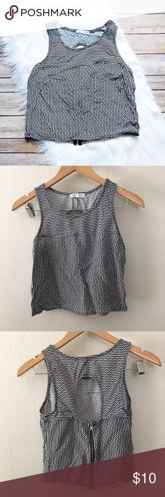 "SOCIALITE Crop Top Black and white scallop pattern crop top. Sleeveless. Rear has large keyhole design and zip up. Somewhat sheer. Cool and lightweight polyester. Offers welcomed.  Armpit: 14"" Shoulder to Hem: 17""   Instagram: @bringingupsuns Socialite Tops Crop Tops"