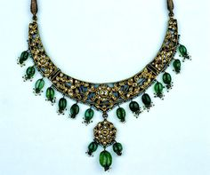 Gold Necklace set with diamonds, edged with a border of seed pearls, and hung with emeralds and seed pearls (front) North India; 19th century