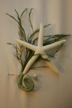 Instead of using traditional boutonnieres for our beach wedding, the groom and groomsmen had mini starfish with a bit of greenery. It was perfect!