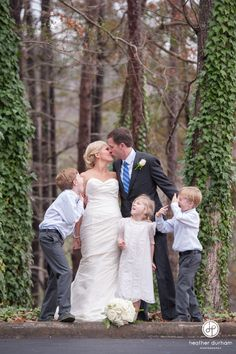 Southern Weddings • Winter Weddings • Bride and Groom kissing portrait with their children • Family wedding portrait • Second wedding • Heather Durham Photography Birmingham Alabama http://www.heatherdurhamphotography.com