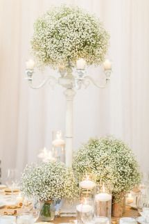Elegant table setting using inexpensive baby's breath, lots of other uses of baby's breath in this wedding