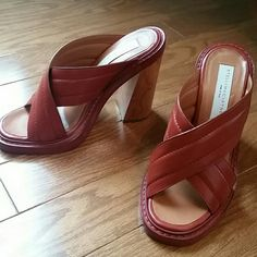 Stella McCartney Eniko Slide Sandals Rust red/orange color, wood heel, made in Italy, number ingraved on leather is 349797 36, beautiful shoes! Barely worn. I bought them because I wanted so badly for them to work, but I'm typically a 5.5/6 and these fit more like a 6/6.5. I feel like they look too big for me when I wear them so I decided to sell. Stella McCartney Shoes Mules & Clogs