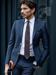 Andres Velencoso Segura is a sharp vision in a navy printed suit from Gucci.