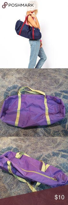 PURPLE AND GREY American Apparel Duffle Bag Product is as shown in the first picture, just in a different color. Never used duffle bag. Great for kids, teens, or anyone else who needs a good sized duffle bag! American Apparel Bags Travel Bags