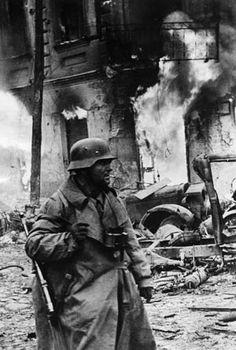 A battle-hardened German panzergrenadier makes his way through the town of Zhytomyr, Ukraine, in December 1943.