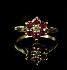 Vintage 14k Gold Flower Cluster Ruby and Diamond Engagement Ring / 14k Yellow Gold. $775.00, via Etsy.