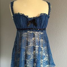 Fredricks of Hollywood Lace Babydoll Gorgeous lace babydoll top from Fredricks of Hollywood. Has a black bow and black lace sequin and bead detailing under the breast. No sequins or beads are missing. It is lightly padded with underwire and without push-up. Color is more of a teal blue. Has been hand washed and is ready for its new owner! No known flaws. Fits size small, size chart is attached. Frederick's of Hollywood Intimates & Sleepwear Chemises & Slips