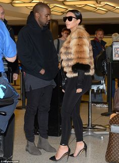 Kim Kardashian wraps up in fluffy coat as she and Kanye West jet out of New York | Daily Mail Online