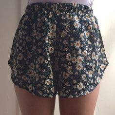 Daisy Shorts (NEW) Super cute daisy shorts! Perfect for the Spring/Summer! It'll be perfect with a white tank and solid color cardigan with your favorite pair of sneakers/sandals! Shorts