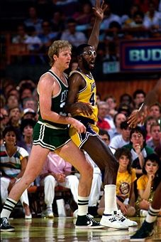 James Worthy #42 of the Los Angeles Lakers posts up against Larry Bird #33 of the Boston Celtics during the 1984 NBA Game at the Forum in Los Angeles, California.