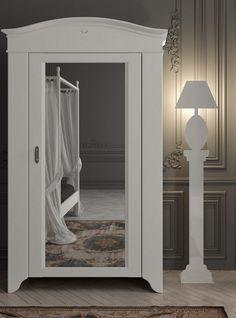 Mirrored solid wood wardrobe SEGURET by Minacciolo #bedroom