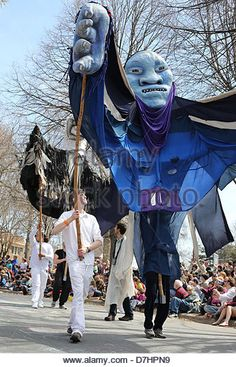 Giant puppets at the May Day parade in Minneapolis, Minnesota. - Stock Image