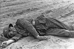 Horror World War 2. Killed instantly by wounds in the neck is not compatible with the life of the the German Wehrmacht Unteroffizier lying on sandy road. Presumably, the Ukraine or the Soviet Baltic republics.