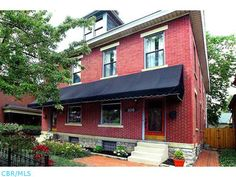 Classic German Village charm! 2112 square-foot renovated 4-bedroom 2-bath condo. Exposed brick walls throughout. Large, updated eat-in kitchen with wine cooler, granite counters and stainless appliances. Wood floors. Updated baths. Private fenced brick patio. 2 working fireplaces. Full basement with vast storage options. Condo shows MAGNIFICENTALLY!