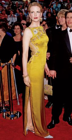 Nicole Kidman  The ultimate red carpet statement dress but who's that creepy short guy?