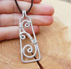 Silver. Aluminum. Wire. Scrollwork. Necklace.