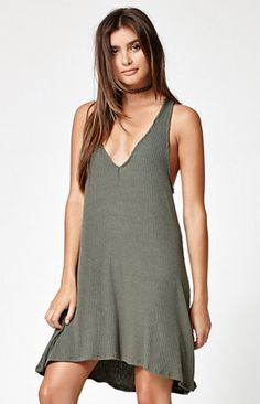 """Work your sweet, feminine style in this solid knit dress from Kendall & Kylie. Available in two washes, this knit dress is accentuated by a plunging neckline, soft, ribbed fabrication and a keyhole detail on back with an adjustable tie.   34'' HPS Unlined Plunging neckline Knit; ribbed Large keyhole on back with adjustable tie Model is wearing a small Model's measurements: Height: 5'8.5"""" Bust: 32"""" Waist: 24"""" Hips: 34"""" 61% polyester, 33% rayon, 6% spandex Hand or machine wash ..."""