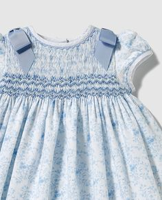Darling smocked dress on tiny blue flower dress. Rick-rack ads a nice touch at neck and sleeves with blue bows at the shoulders ♥ Smocking Baby, Smocking Patterns, Girls Smocked Dresses, Little Girl Dresses, Blue Flower Dress, Flower Dresses, Frocks For Girls, Smock Dress, Kids Outfits