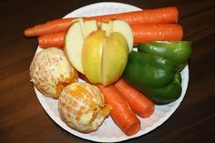 2 Oranges (peeled)  1 Green Pepper (seeded)  1 Apple (cored)   4 Carrots