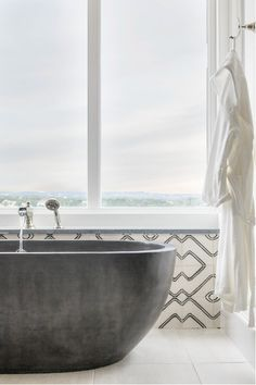 Sink into a silky-smooth concrete bathtub, the Avalon by Native Trails. Pictured here: an Austin, TX, master bath with a view, by Kelle Contine Interior Design