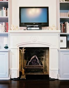 Geode in the fireplace.too bad we can't do this with our gas fireplace.at least I don't think? Over Fireplace Decor, Farmhouse Fireplace Mantels, Fake Fireplace, Fireplace Built Ins, Fireplace Hearth, Modern Fireplace, Living Room With Fireplace, Fireplace Design, Fireplaces