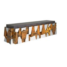 PAUL EVANS (1931 - 1987) DIRECTIONAL Faceted wall-mounting cabinet, USA, 1970s; Chromed steel, birds-eye maple burl, gel-coated fiberglass; 23 x 96 x 25 Features two bi-fold doors revealing two adjustable shelves and a laminated interior.