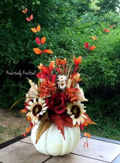 Up for your consideration is a gorgeous fall centerpiece. The base is a realistic large, Styrofoam pumpkin and is loaded with beautiful fall flowers. Red & cream roses, mums, ferns & leaves and of course sunflowers really draw attention to this piece. There are also many fillers that bring this piece together. Nice quality artificial floral stems will provide years of beauty!!!  This centerpiece is large, measuring approximately 19 in height (not including the tall branches of leaves), and…