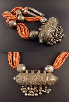 Yemen   Necklace; with bedouin silver hirz decorated with filigree, silver and silver alloy beads, combined with coral   ca. 1930s   1'100€