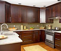 muted green backsplash in this kitchen.