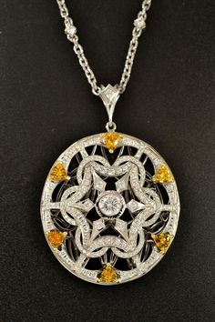 . It has over 2 carats of diamonds and 6 beautiful yellow sapphires all set in platinum. The pendant is hung on a platinum chain that has diamonds set throughout it.