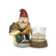 """Gnick - Gardening Gnome Votive Holder  Item #:  P91032  Red-capped friend tends to his patch of the garden. Includes glass votive cup for use with a votive or tealight, sold separately. Weather-resistant, hand-painted, resin. 4 3/4""""h, 5 1/2""""w   Price:  $15.00 each   SHOP:  www.partylite.biz.madeforyou"""