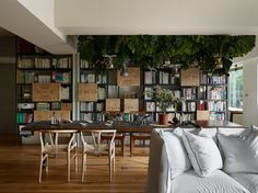 Designed by Ganna Studio, this one-bedroom apartment in Taiwan features weathered wood finishes and mismatched furniture that give it a charming, rustic cafe-inspired look. Rustic Cafe, Home Libraries, One Bedroom Apartment, Apartment Goals, Contemporary Interior Design, Contemporary Buildings, Home Pictures, Minimalist Home, Interiores Design