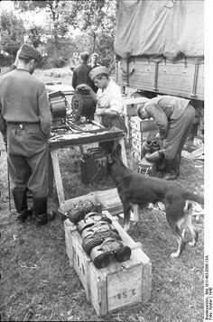 1940, France, Des soldats allemands remplissent des tambours pour batterie de canons de 2cm | by ww2gallery