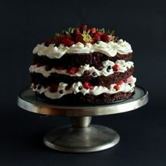 Chocolate cake layered with whipped cream and fresh fruits.