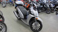 New 2013 Kymco People GT 200i Motorcycles For Sale in New Hampshire,NH. 2013 KYMCO People GT 200i, Sale price of $3995 is out the door. Fuel Injected with ABS, lots of storage and a 2 year factory warranty. Marked below cost, this is a steal!! Finance options for all credit types.